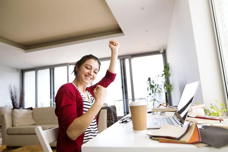 Woman Winning on Her Computer