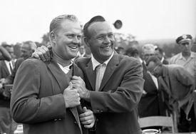 Arnold Palmer (right) helps Jack Nicklaus slip on the Green Jacket after the 1965 Masters