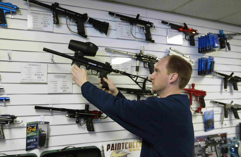 Man returns a Tipman A-5 gun to its display..