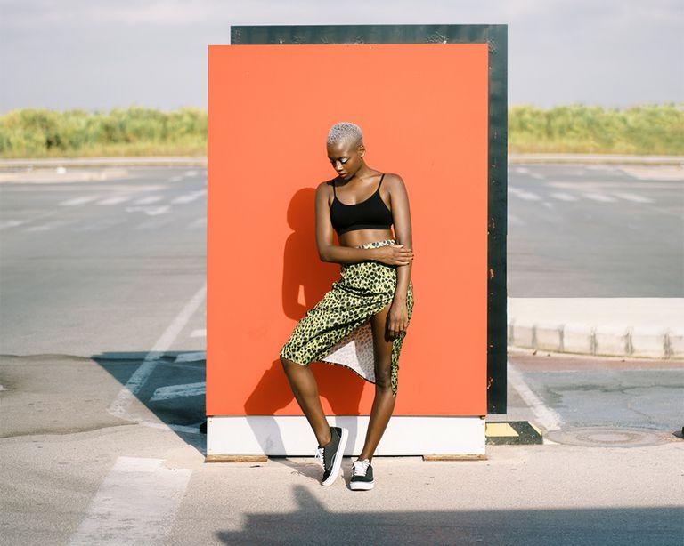 black femme posing in sun