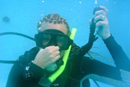 Natalie Novak doing an underwater demonstration