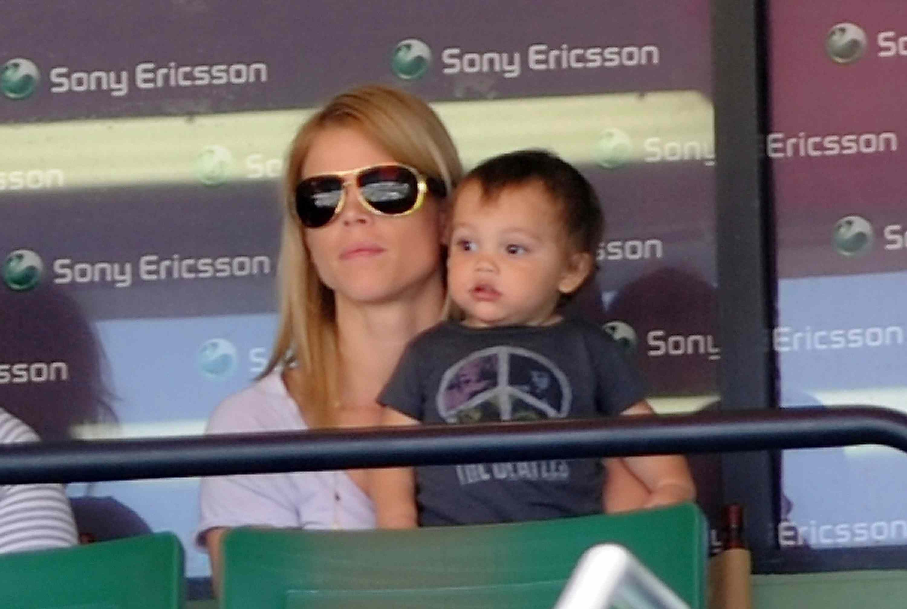 Baby Charlie Woods and mother Elin Nordegren at a tennis match in 2010