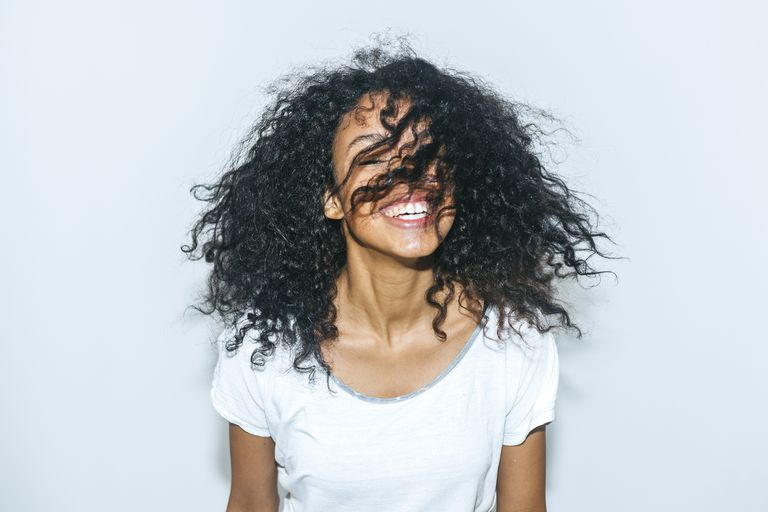 Smiling black woman with curly hair