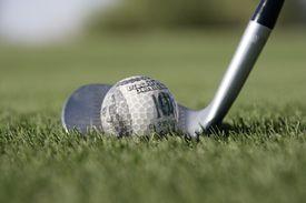 A golf ball made of money