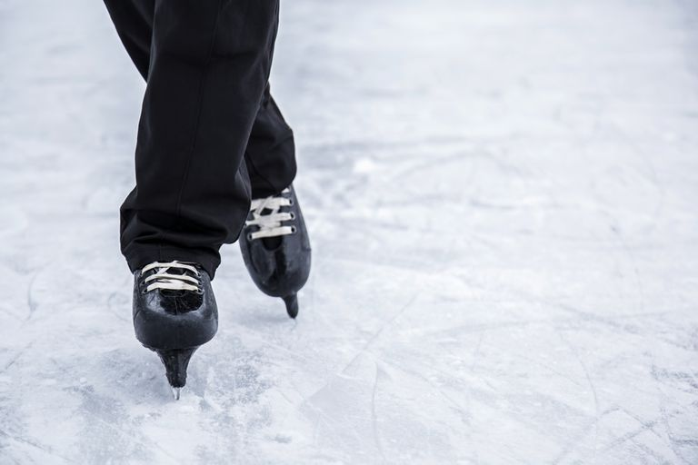 Man skating and training with black skates