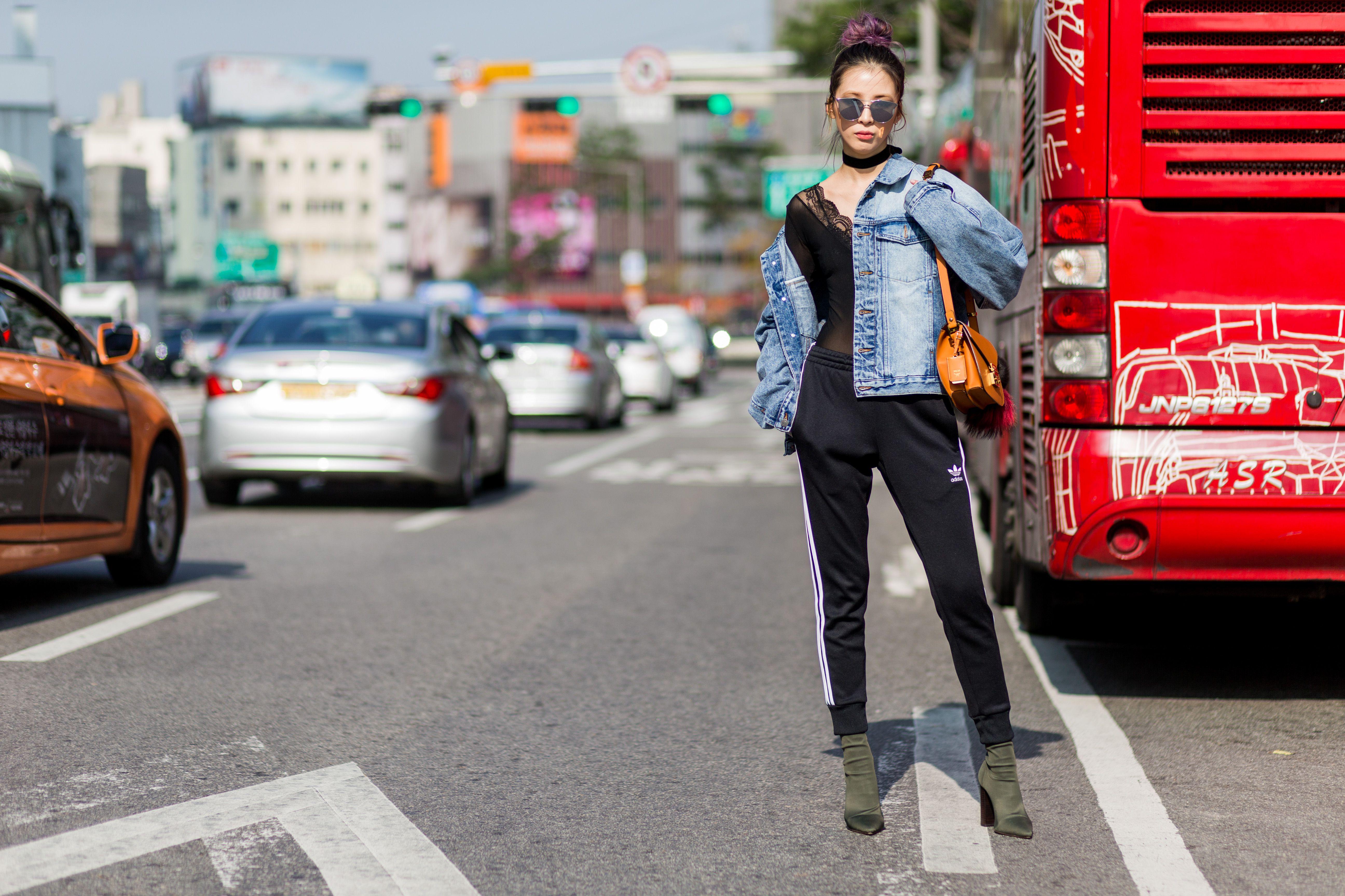 Irene Kim posing in a city street