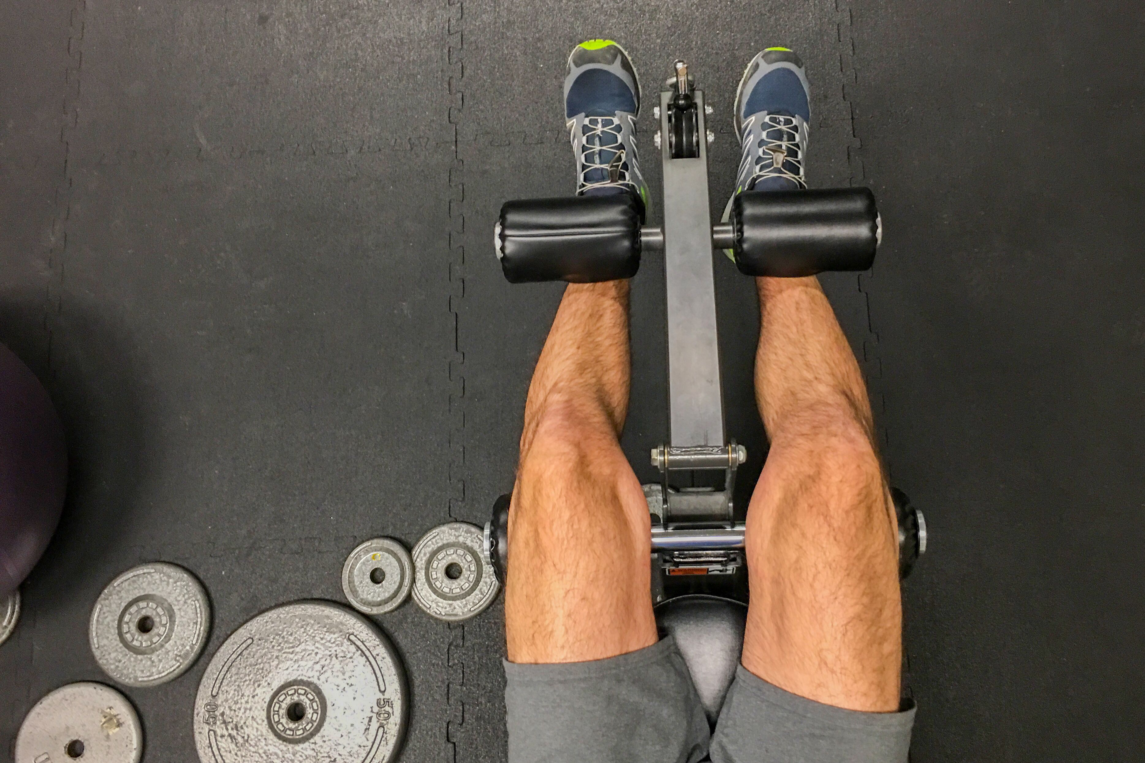 lower section of man doing leg extensions