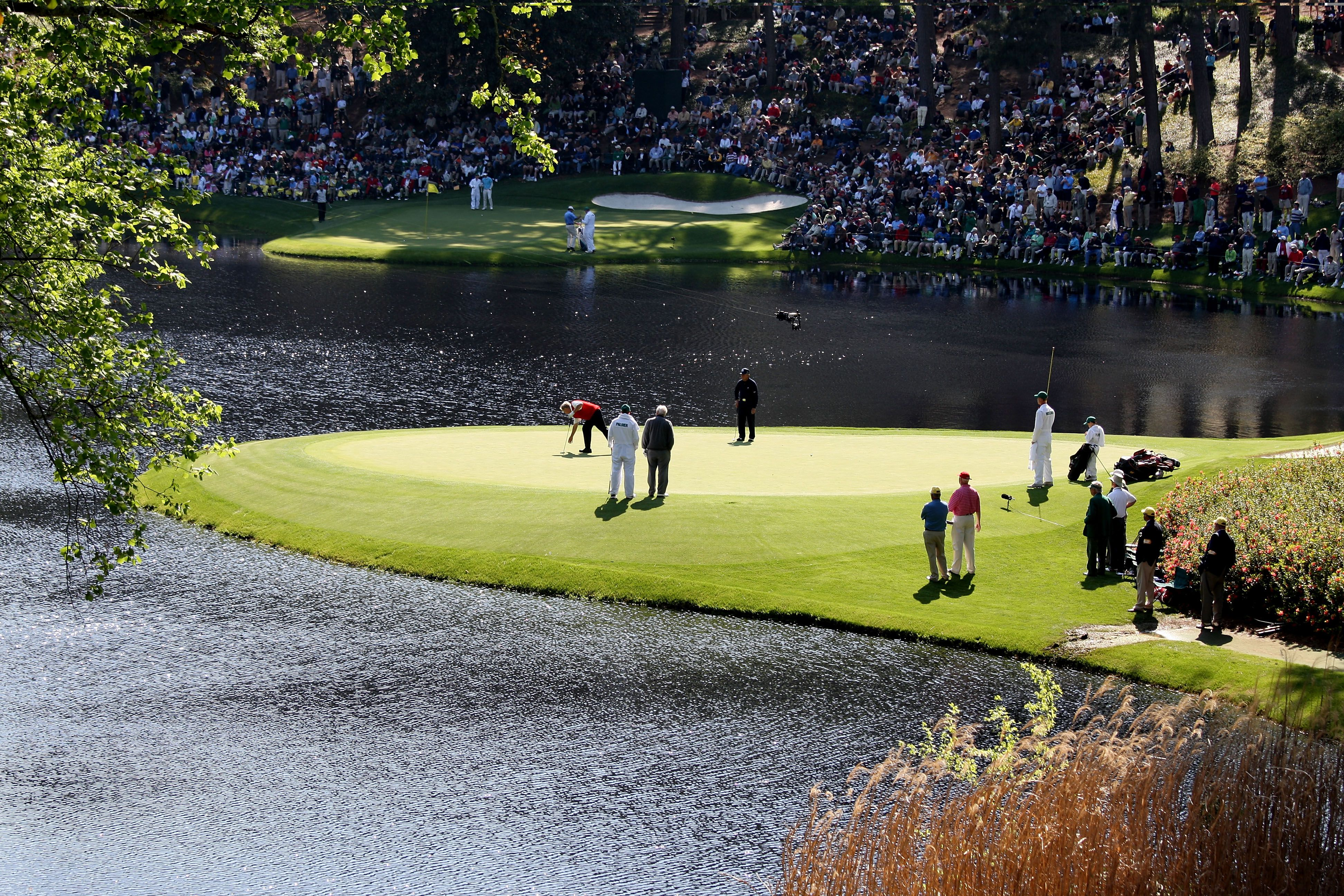 Gary Player, Arnold Palmer and Jack Nicklaus in action on the eighth green during the Par 3 Contest prior to the 2009 Masters Tournament