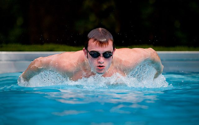 high school swimmer doing butterfly