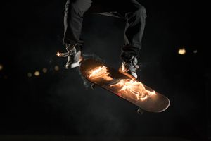 Skateboarder performing a flaming ollie