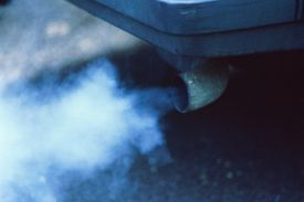 CAR EXHAUST PUMPING OUT FUMES