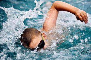 Boy swimming close-up
