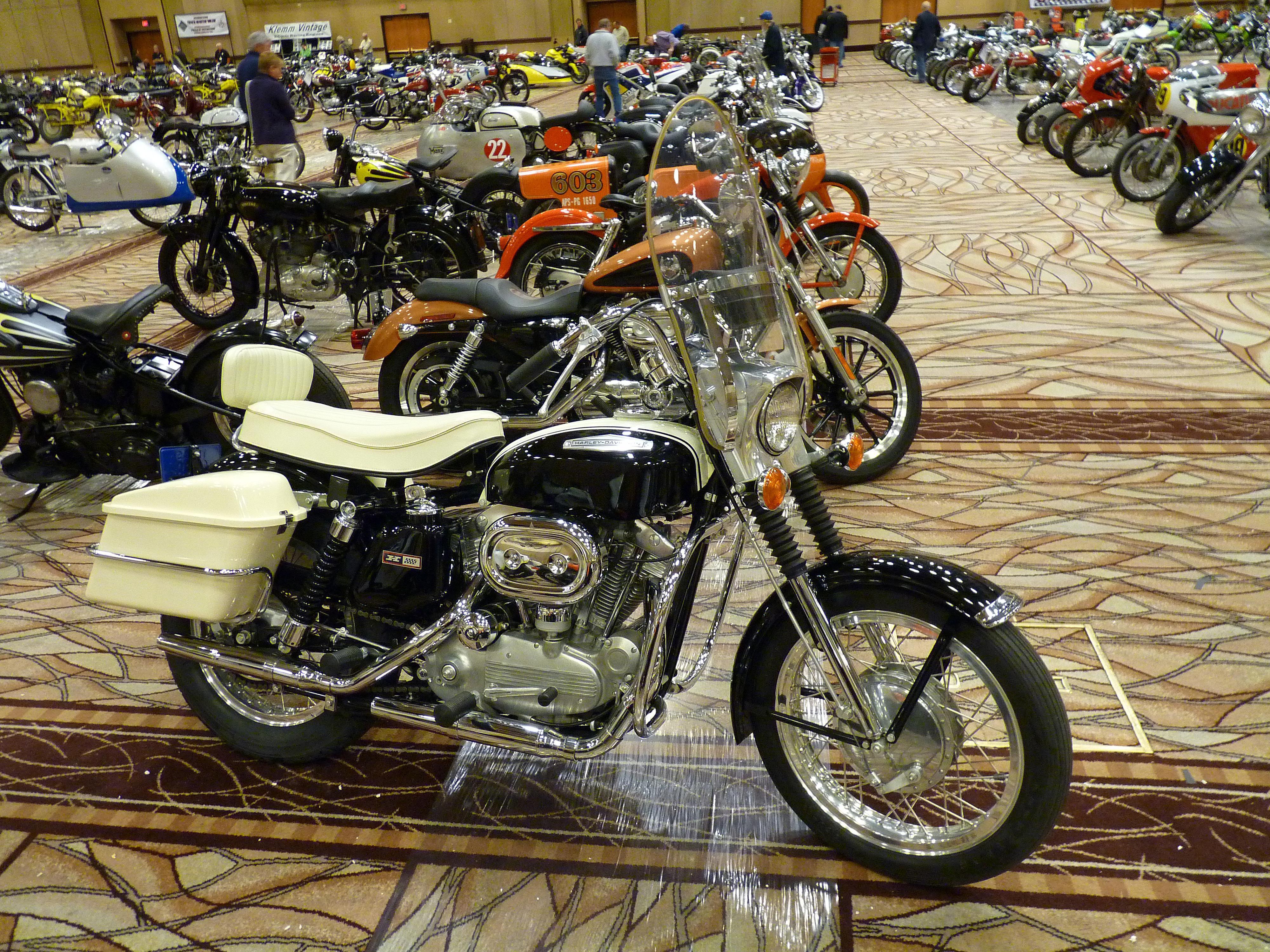 Harley Sportster on display in a showroom.