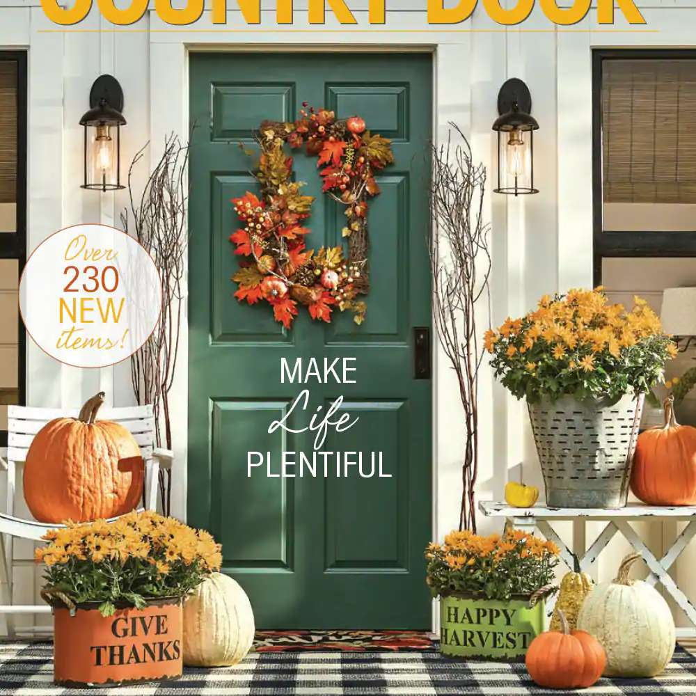 The Fall 2019 catalog cover from Through the Country Door featuring a fall porch