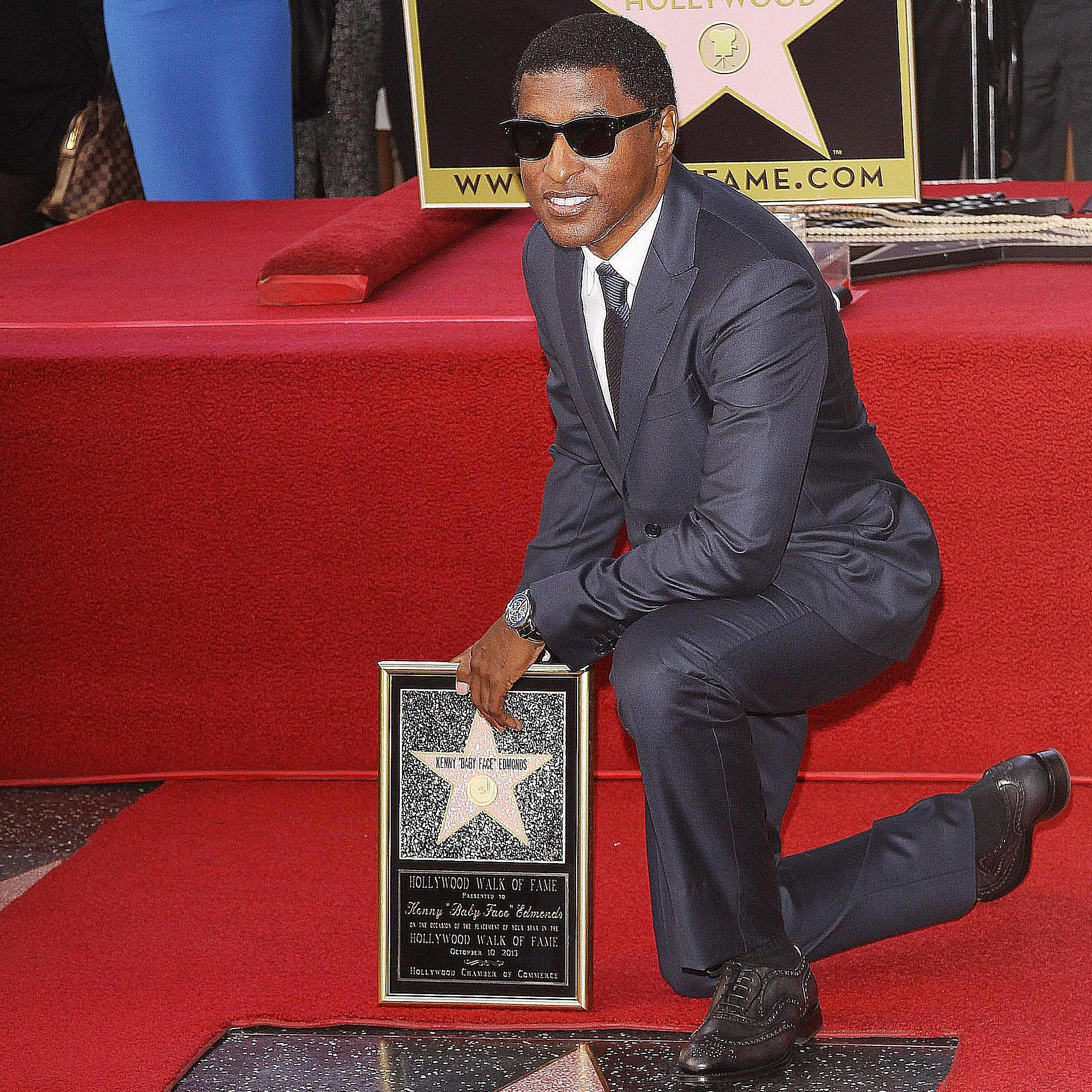 Babyface poses with his star on the Hollywood Walk of Fame