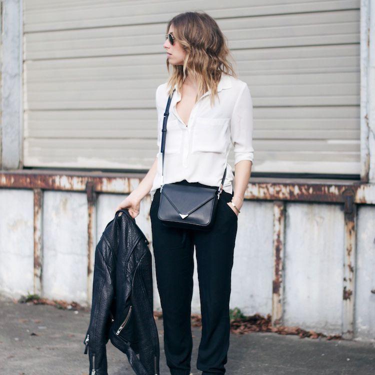 Woman wearing white shirt and black pants