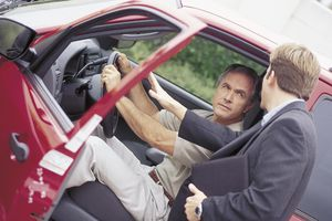 Man buying a used car