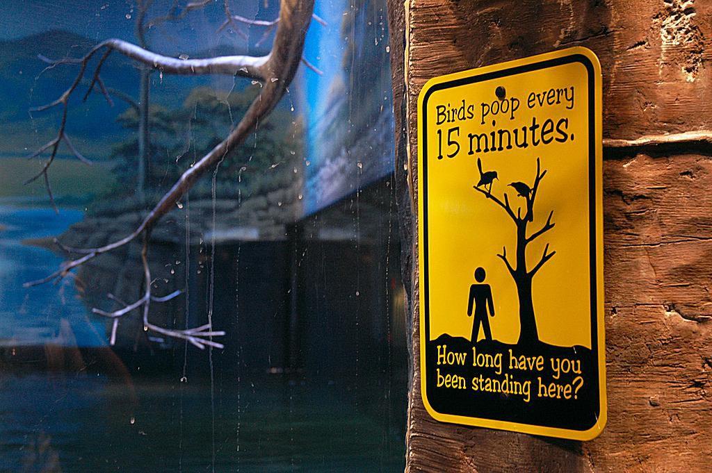 bird poop zoo sign