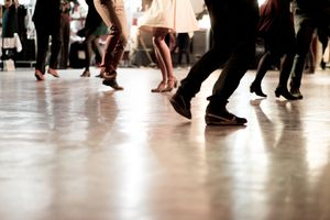 Low Section Of People Dancing On Floor