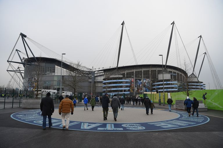 Fans outside the Etihad Stadium