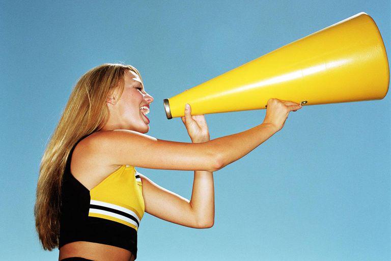 Cheerleader yelling through megaphone