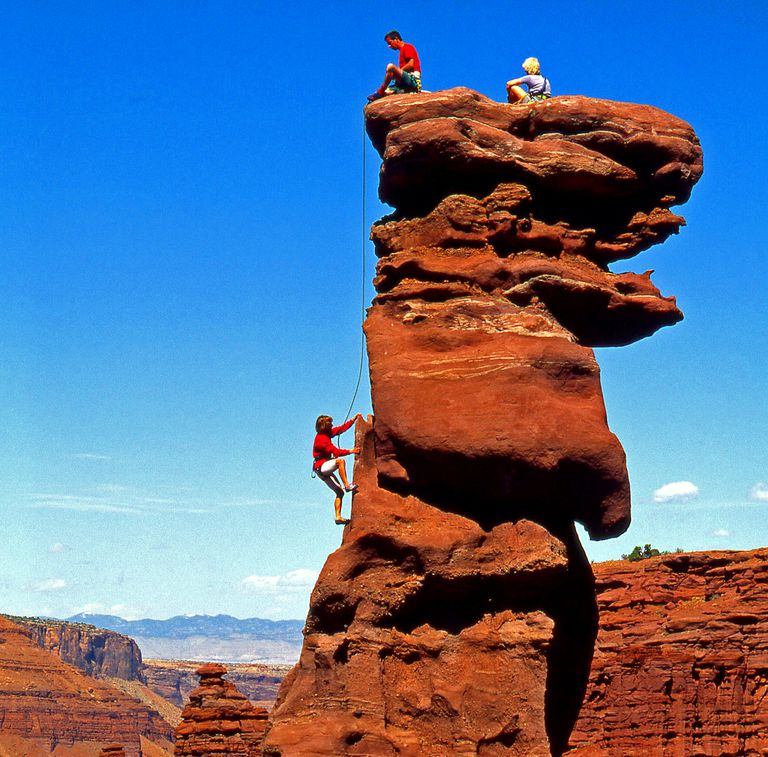 Dennis belays Martha Morris on Lizard Rock at the Fisher Towers, Utah.