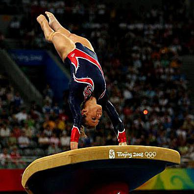 Gymnast Alicia Sacramone performs on vault at the 2008 Olympics in gymnastics
