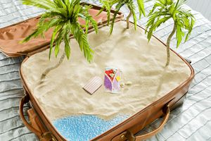 Photo of a beach in a suitcase, illustrating About.com's Vacation Sweepstakes List.