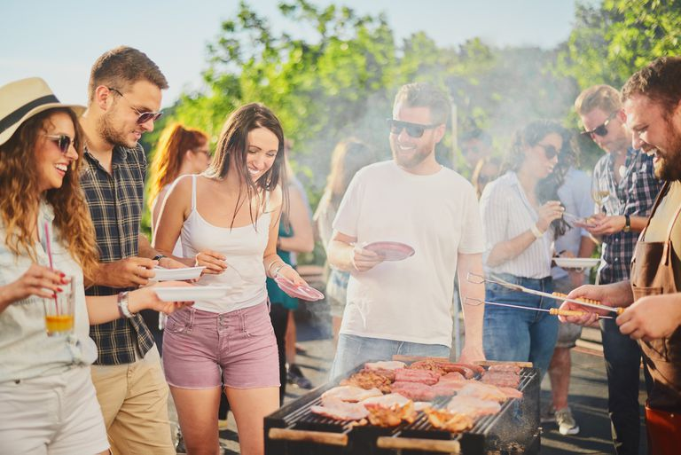 Group of Friends Standing Around Grill