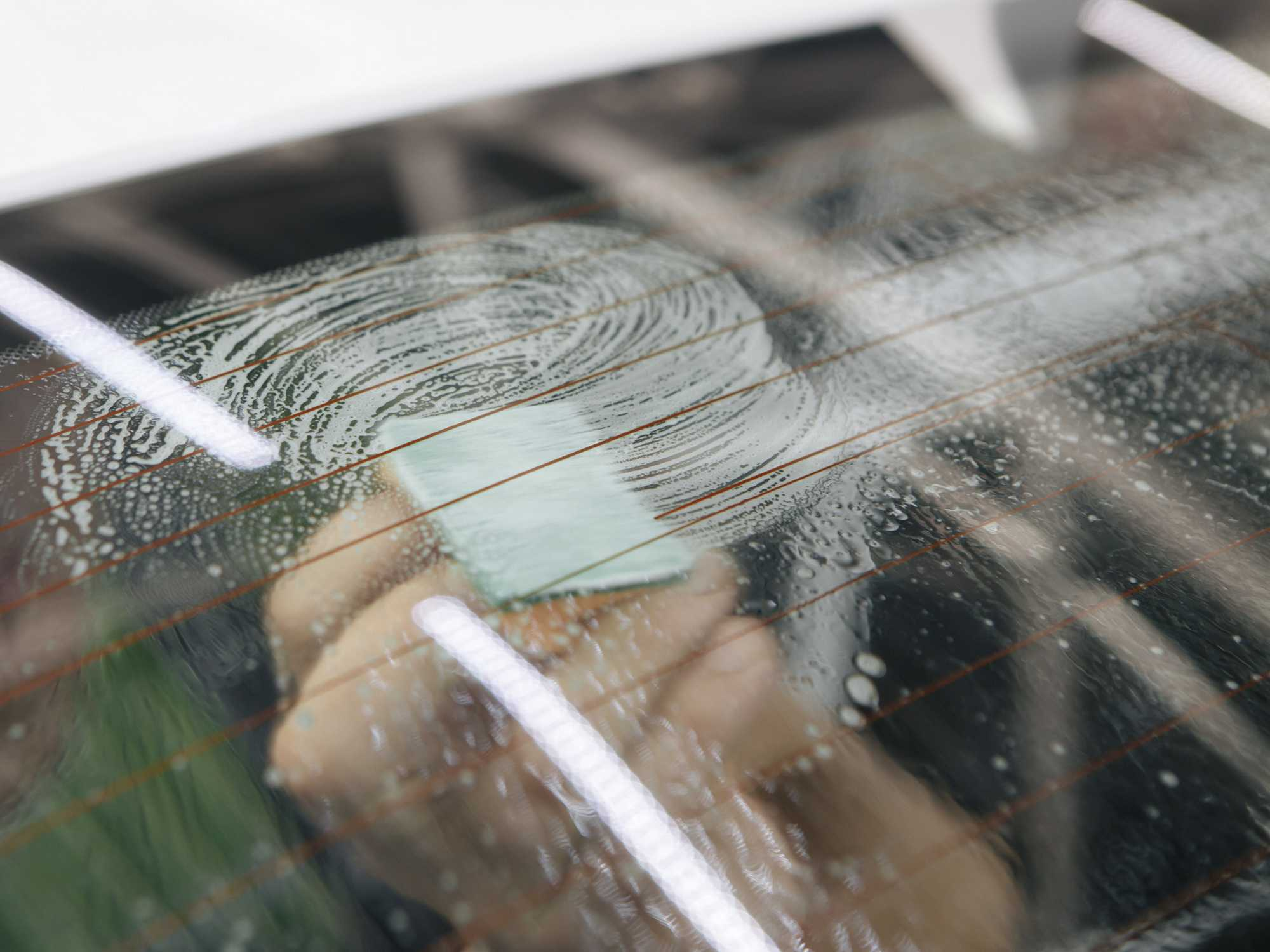 using steel wool to remove window tint adhesive