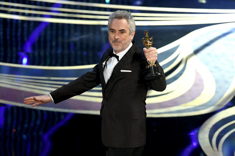 Filmmaker Alfonso Cuaron accepting the Academy Award for Best Cinematography
