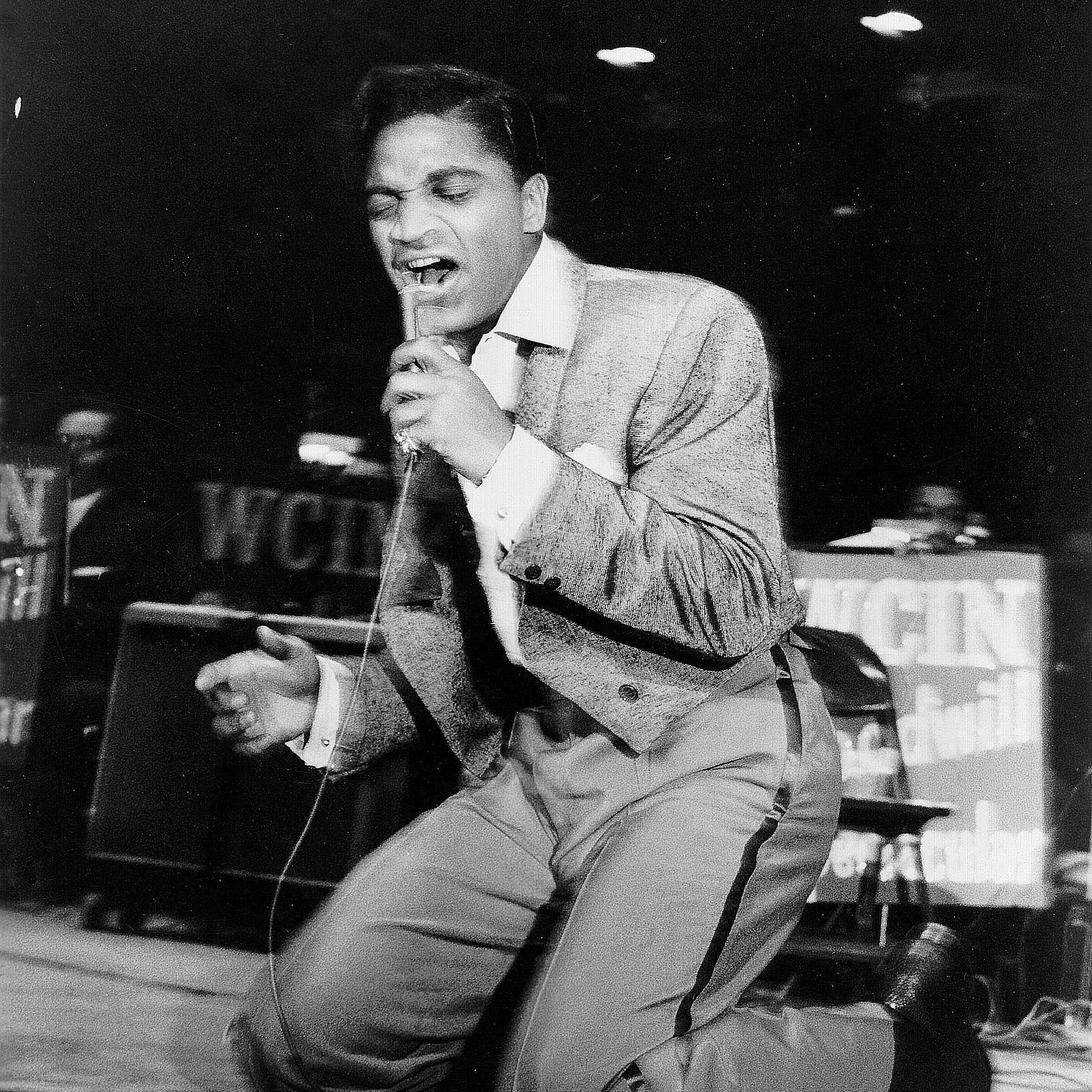 Jackie Wilson singing during a performance