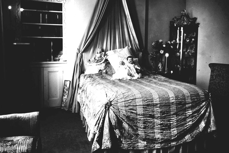 Creepy black and white photo of a child's bedroom