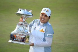 Inbee Park of South Korea holds the trophy after winning the KPMG Women's PGA Championship held at Westchester Country Club on June 14, 2015