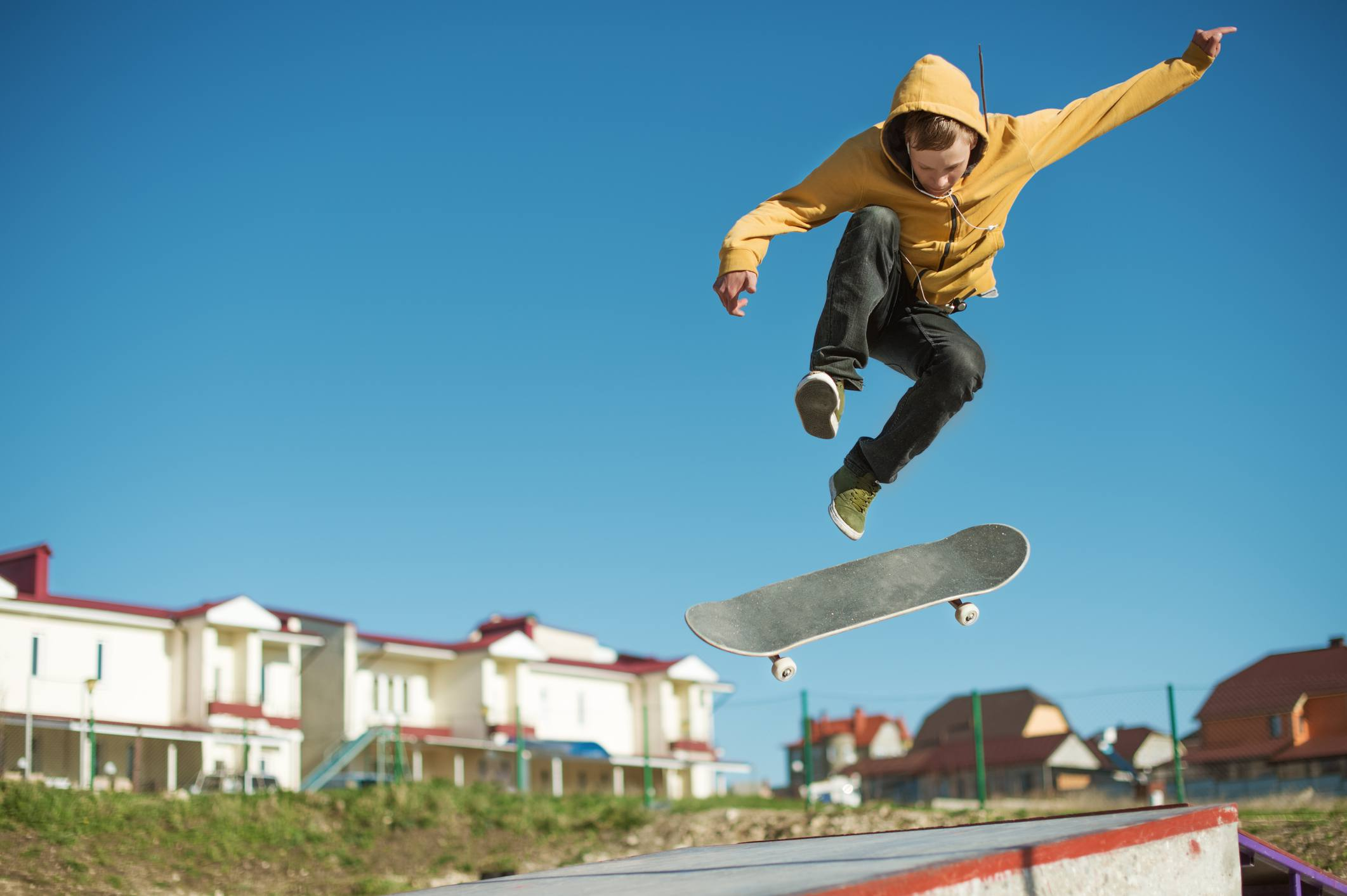 A teenager skateboarder does an flip trick
