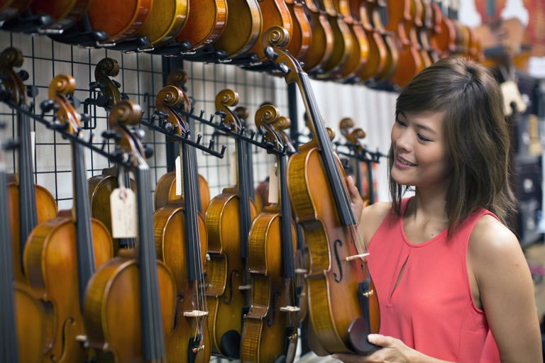 Woman shopping looking at violin