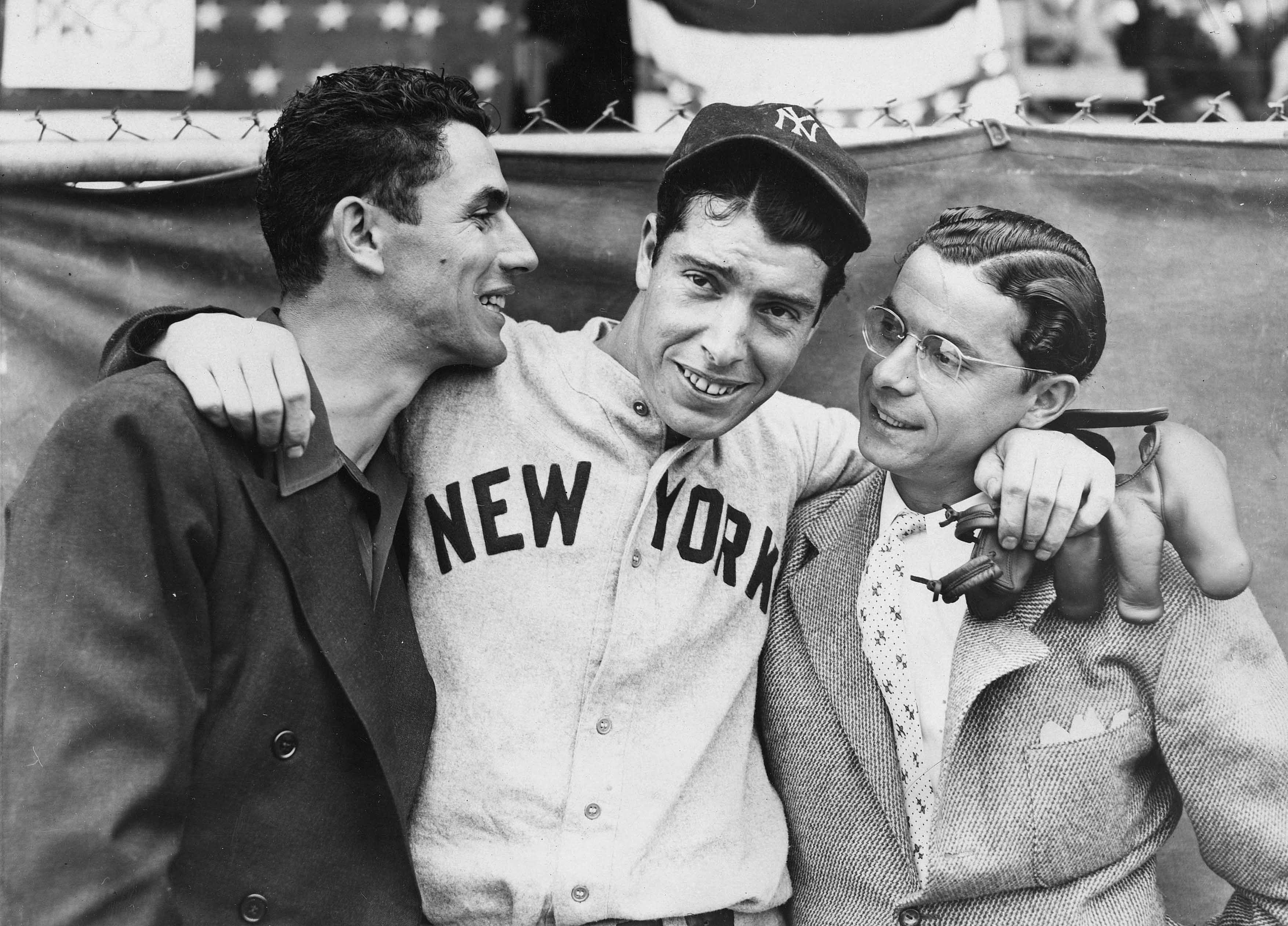 Rookie Joe DiMaggio, center, hugs his brothers Vince, left, and Dom, before the start of the 1936 World Series