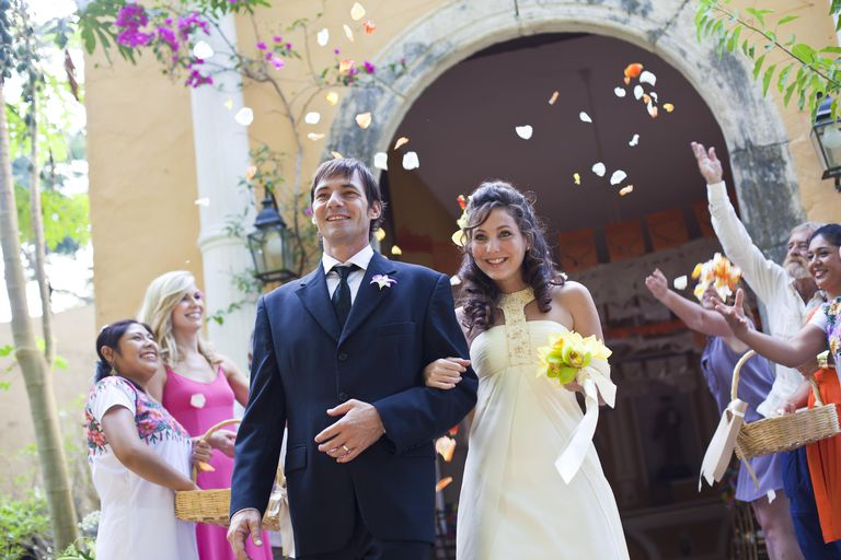 Bride and groom outside chapel in Mexico