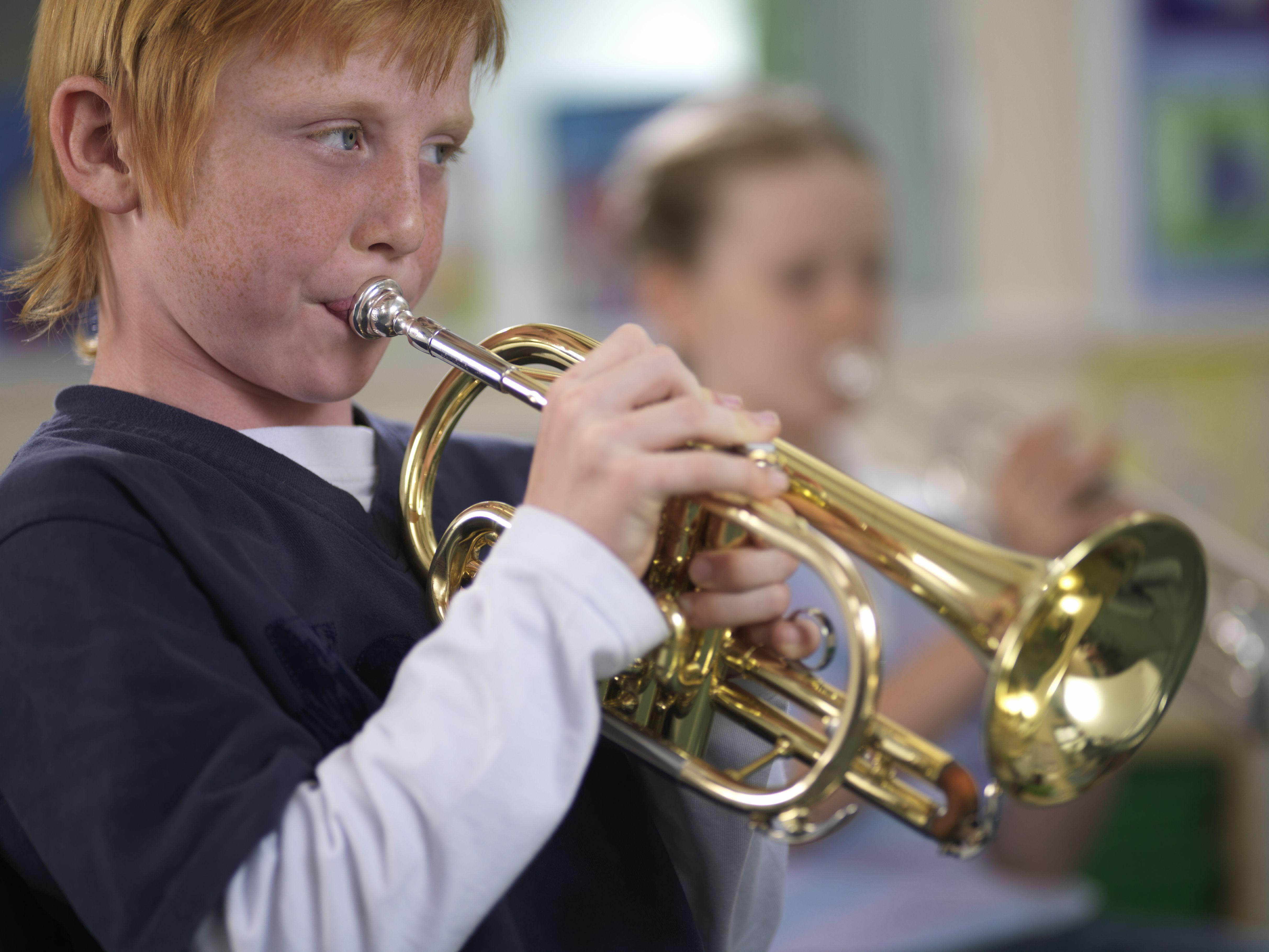 Boy Playing Cornet in Music Class