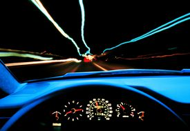 Dashboard of a car on the road at night