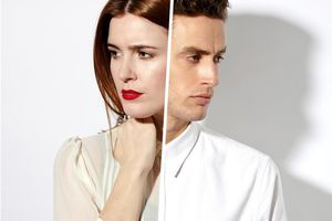 A man and a woman facing away from each other