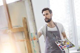 Man painting at easel