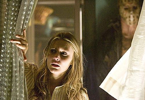 Bree (Julianna Guill, left) and Jason (Derek Mears) in 'Friday the 13th'.