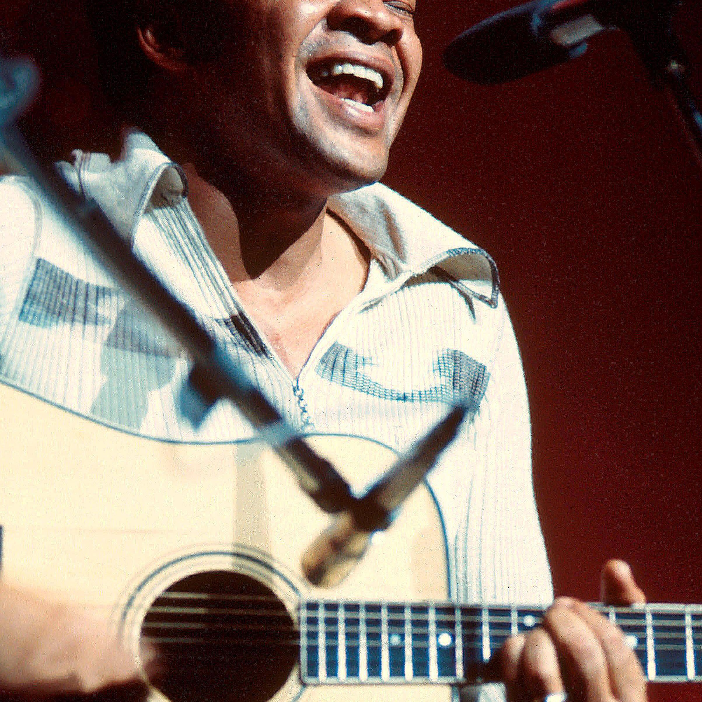 Bill Withers singing during a performance