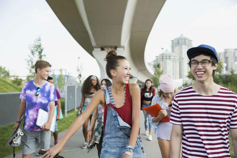 Laughing teenagers walking