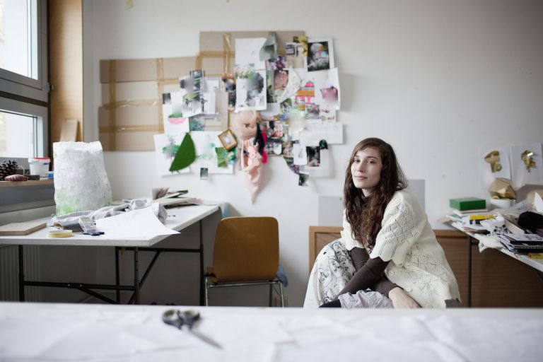 Portrait of female fashion designer in studio