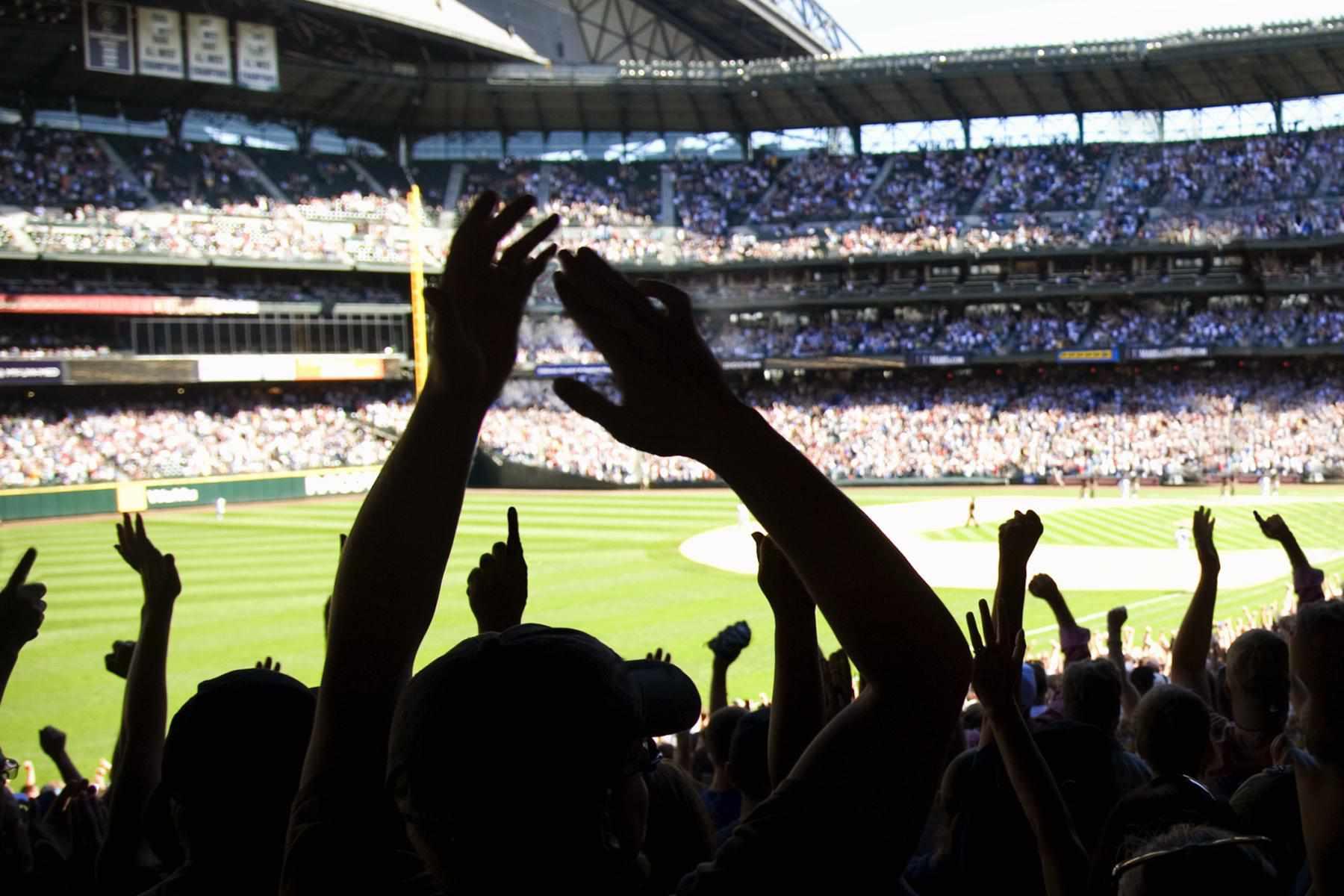 Baseball fans cheering in stadium