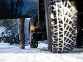 Ground view of a jeep tyre on a snow-covered road