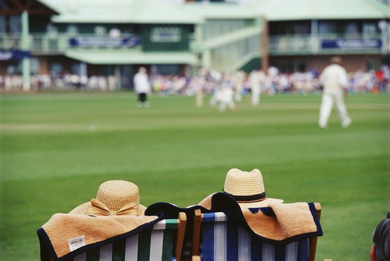 Men Watching Cricket Game
