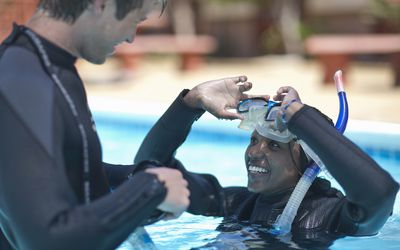 a scuba instructor and his pupil